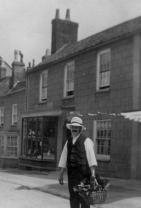 Man with basket, High St